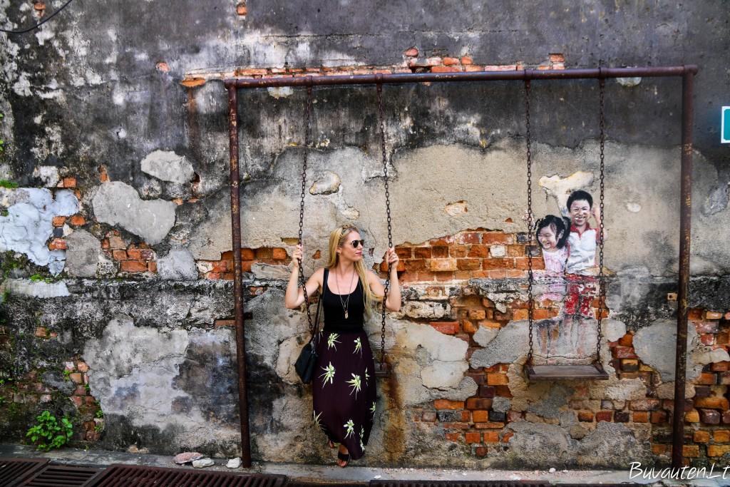 Kito menininko darbas ant Džordžtauno sienos - Louis Gan